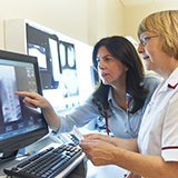 Doctor and nurse examine diagnostic image