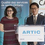 Man and woman speaking at the launch of an ARTIC initiative