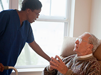 A man in a long-term care home is getting assistance